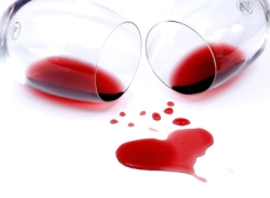 Red wine spilled from glasses